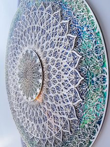 Julia Ibbini -  <strong>The Story of the Peacock (detail)</strong> (2017<strong style = 'color:#635a27'></strong>)<bR /> lasercut paper over ink on mylar, 47 x 36.75 inches (framed)