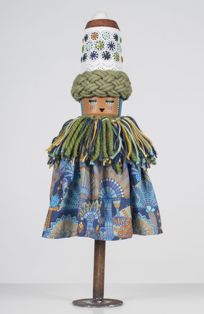 Koralie -  <strong>Eleoranus (God of Wind and Sky)</strong> (2018<strong style = 'color:#635a27'></strong>)<bR /> porcelain, wood, fabric and metal, 16 x 8 inches $500