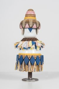 Koralie -  <strong>Balderelios (Goddess of Light)</strong> (2018<strong style = 'color:#635a27'></strong>)<bR /> porcelain, wood, fabric and metal, 12.5 x 6 inches $500