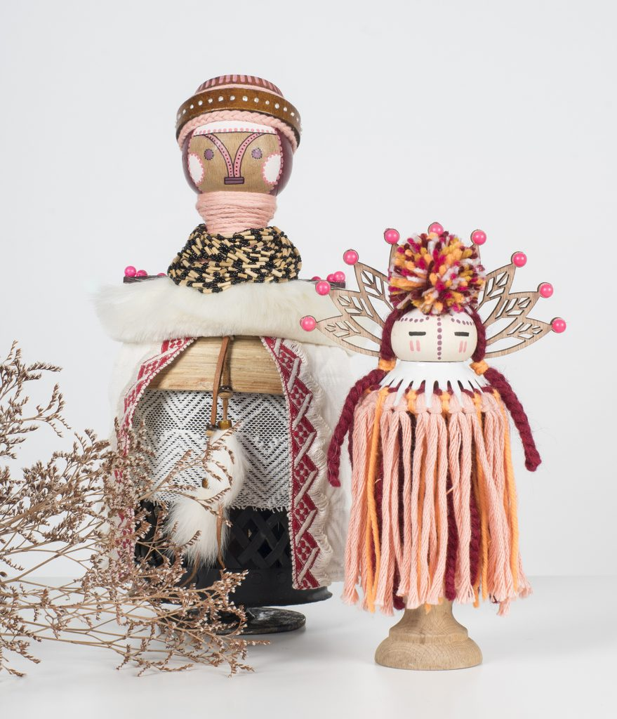 Koralie -  <strong>Ceressea (Goddess of Cultivation) (left) and Selenas (Goddess of the Moon)  (right)</strong> (2018<strong style = 'color:#635a27'></strong>)<bR /> porcelain, wood, fabric and metal, 13 x 7 inches (left), 10 x 6 inches (right) 500 (left) $400 (right)