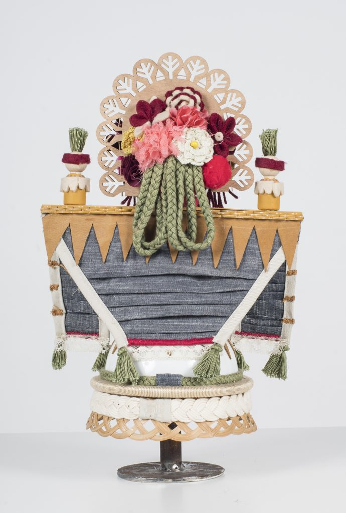 Koralie -  <strong>Chloristopec (Goddess of Flowers and Spring) (back)</strong> (2018<strong style = 'color:#635a27'></strong>)<bR /> porcelain, wood, fabric and metal, 16 x 9.5 inches $600