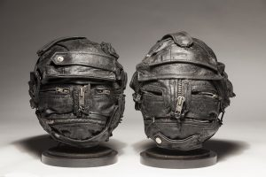 Ronald Gonzalez -  <strong>Zipped and Unzipped Couple</strong> (2017<strong style = 'color:#635a27'></strong>)<bR /> manipulated found objects, wax, wire, soot, metal filings over welded steel,  12 x 10 x 10 inches, $4,500