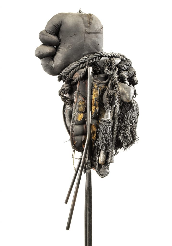 Ronald Gonzalez -  <strong>Fetish (side)</strong> (2015<strong style = 'color:#635a27'></strong>)<bR /> manipulated found objects, wax, wire, soot, metal filings over welded steel, 65 x 13 inches