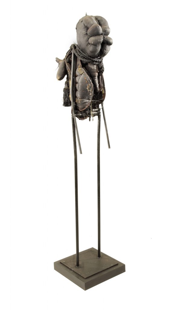 Ronald Gonzalez -  <strong>Fetish</strong> (2015<strong style = 'color:#635a27'></strong>)<bR /> manipulated found objects, wax, wire, soot, metal filings over welded steel, 65 x 13 inches