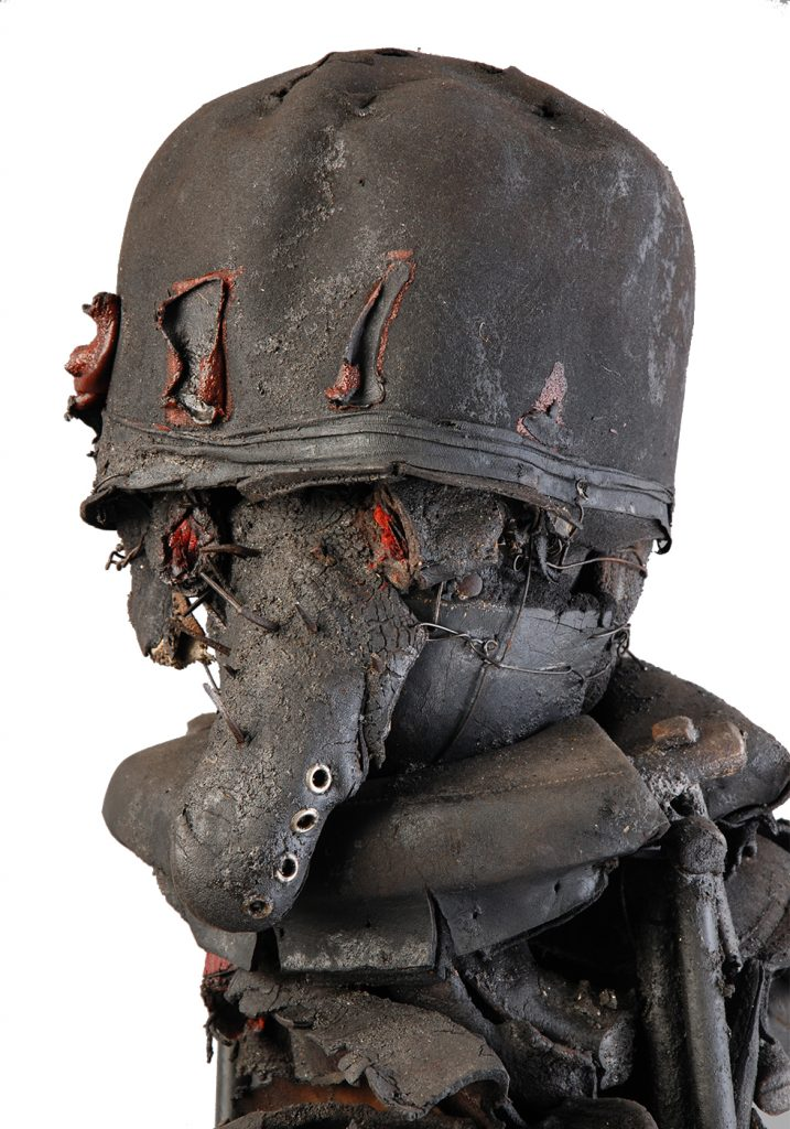 Ronald Gonzalez -  <strong>Snout (detail)</strong> (2017<strong style = 'color:#635a27'></strong>)<bR /> manipulated found objects, wax, wire, soot, metal filings over welded steel, 65 x 13 inches