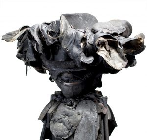Ronald Gonzalez -  <strong>Winged Hat (detail)</strong> (2017<strong style = 'color:#635a27'></strong>)<bR /> manipulated found objects, wax, wire, soot, metal filings over welded steel, 65 x 13 inches