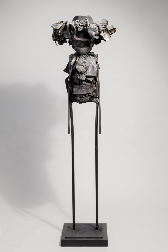 Ronald Gonzalez -  <strong>Winged Hat</strong> (2017<strong style = 'color:#635a27'></strong>)<bR /> manipulated found objects, wax, wire, soot, metal filings over welded steel, 65 x 13 inches, $4,500