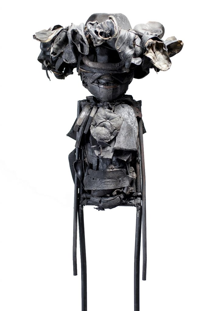Ronald Gonzalez -  <strong>Winged Hat</strong> (2017<strong style = 'color:#635a27'></strong>)<bR /> manipulated found objects, wax, wire, soot, metal filings over welded steel, 65 x 13 inches