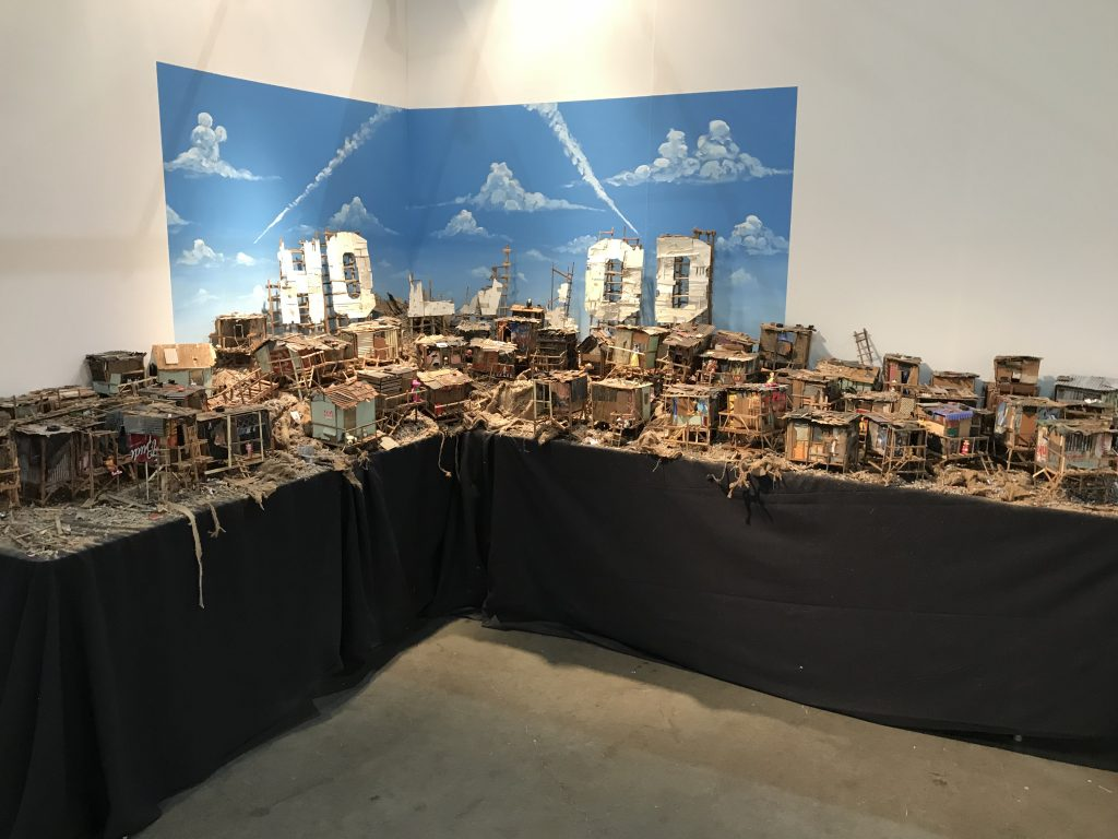 Jeff Gillette -  <strong>Hollywood Hood</strong> (2017<strong style = 'color:#635a27'></strong>)<bR /> found materials from the Mojave Desert, collected refuse and re-purposed paintings, signed and numbered series of 300