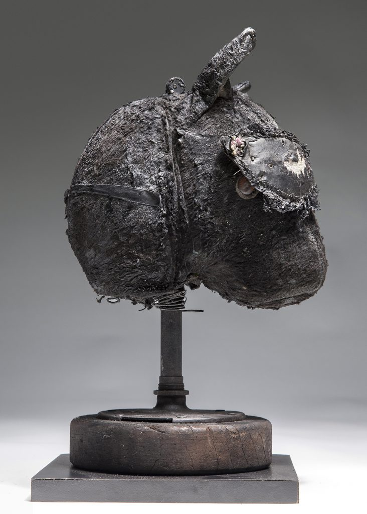 Ronald Gonzalez -  <strong>Sleeping Animal (side)</strong> (2016<strong style = 'color:#635a27'></strong>)<bR /> manipulated found objects, wax, wire, soot, metal filings over welded steel,  13 x 7 x 7 inches