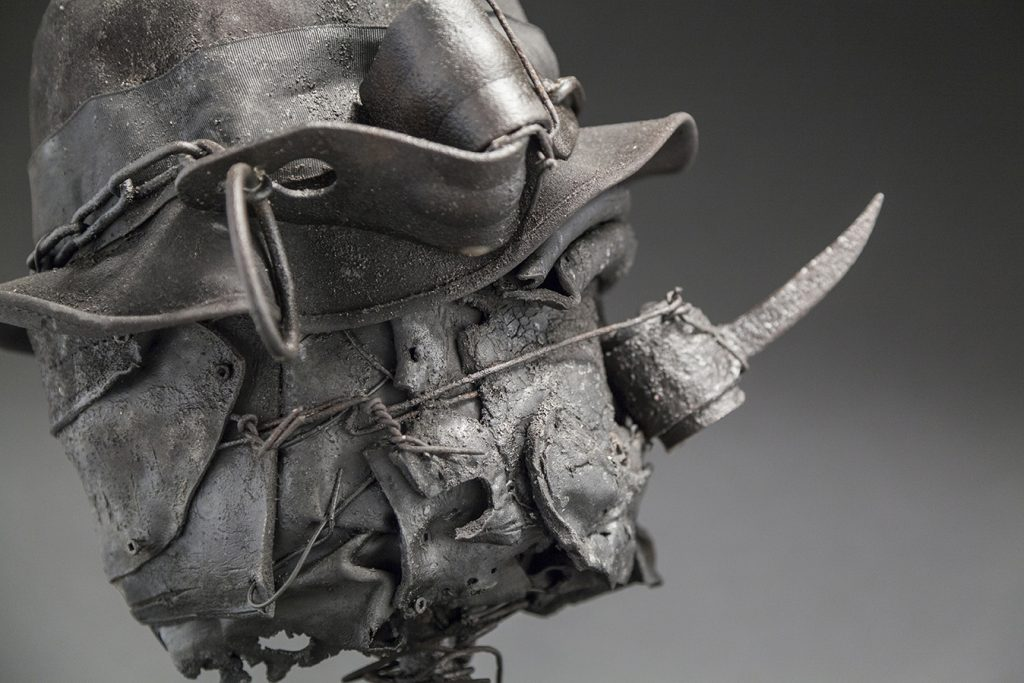 Ronald Gonzalez -  <strong>Spike (detail)</strong> (2017<strong style = 'color:#635a27'></strong>)<bR /> manipulated found objects, wax, wire, soot, metal filings over welded steel,  14 x 10 x 10 inches
