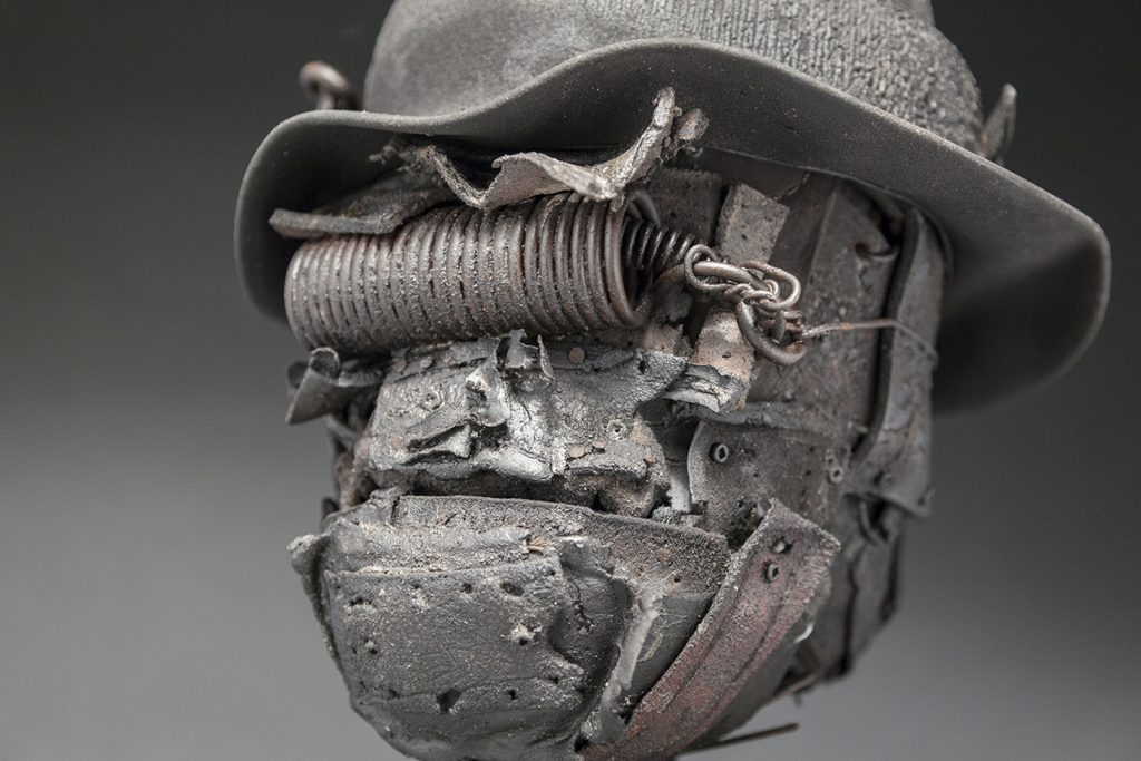 Ronald Gonzalez -  <strong>Tight Spring (detail)</strong> (2017<strong style = 'color:#635a27'></strong>)<bR /> manipulated found objects, wax, wire, soot, metal filings over welded steel,  11 x 8 x 8 inches