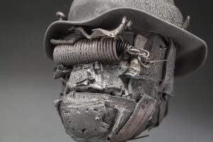 Ronald Gonzalez -  <strong>Tight Spring (detail)</strong> (2017<strong style = 'color:#635a27'></strong>)<bR /> manipulated found objects, wax, wire, soot, metal filings over welded steel,  11 x 8 x 8 inches $2,250