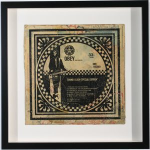 Shepard Fairey -  <strong>Sound Clash</strong> (2007<strong style = 'color:#635a27'></strong>)<bR /> hand painted multiple silkscreen collage on album cover 12 x 12 inches