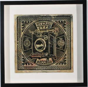 Shepard Fairey -  <strong>Stereo Type Records</strong> (2007<strong style = 'color:#635a27'></strong>)<bR /> hand painted multiple silkscreen collage on album cover 12 x 12 inches