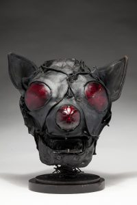 Ronald Gonzalez -  <strong>Bat</strong> (2018<strong style = 'color:#635a27'></strong>)<bR /> black leather, found objects, wire, wax, carbon, screws and metal filings over welded steel armatures, 12 x 11 x 11 inches