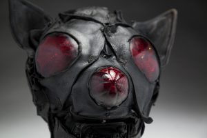 Ronald Gonzalez -  <strong>Bat (detail)</strong> (2018<strong style = 'color:#635a27'></strong>)<bR /> black leather, found objects, wire, wax, carbon, screws and metal filings over welded steel armatures, 12 x 11 x 11 inches