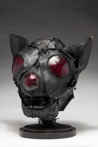 Ronald Gonzalez -  <strong>Bat (side)</strong> (2018<strong style = 'color:#635a27'></strong>)<bR /> black leather, found objects, wire, wax, carbon, screws and metal filings over welded steel armatures, 12 x 11 x 11 inches