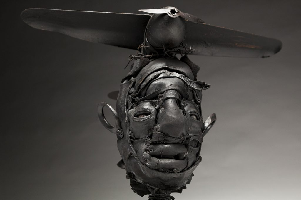 Ronald Gonzalez -  <strong>Black Wings (detail)</strong> (2018<strong style = 'color:#635a27'></strong>)<bR /> black leather, found objects, wire, wax, carbon, screws and metal filings over welded steel armatures,  14 x 19 x 13 inches