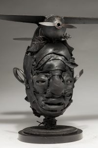 Ronald Gonzalez -  <strong>Black Wings</strong> (2018<strong style = 'color:#635a27'></strong>)<bR /> black leather, found objects, wire, wax, carbon, screws and metal filings over welded steel armatures,  14 x 19 x 13 inches
