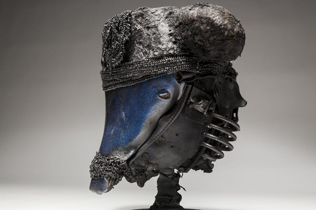 Ronald Gonzalez -  <strong>Black and Blue (side)</strong> (2018<strong style = 'color:#635a27'></strong>)<bR /> black leather, found objects, wire, wax, carbon, screws and metal filings over welded steel armatures,  	 12 x 11 x 11 inches