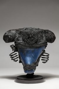 Ronald Gonzalez -  <strong>Black and Blue</strong> (2018<strong style = 'color:#635a27'></strong>)<bR /> black leather, found objects, wire, wax, carbon, screws and metal filings over welded steel armatures,  	 12 x 11 x 11 inches
