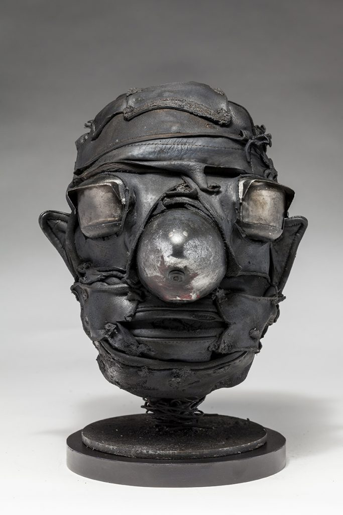 Ronald Gonzalez -  <strong>Cone</strong> (2018<strong style = 'color:#635a27'></strong>)<bR /> black leather, found objects, wire, wax, carbon, screws and metal filings over welded steel armatures.  	11 x 9 x 10 inches