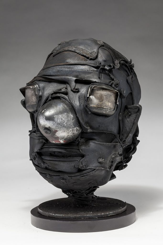 Ronald Gonzalez -  <strong>Cone (side)</strong> (2018<strong style = 'color:#635a27'></strong>)<bR /> black leather, found objects, wire, wax, carbon, screws and metal filings over welded steel armatures.  	11 x 9 x 10 inches