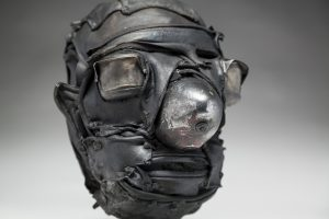 Ronald Gonzalez -  <strong>Cone (detail)</strong> (2018<strong style = 'color:#635a27'></strong>)<bR /> black leather, found objects, wire, wax, carbon, screws and metal filings over welded steel armatures.  	11 x 9 x 10 inches