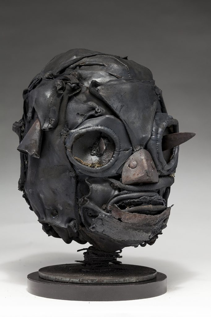 Ronald Gonzalez -  <strong>Daggers (side)</strong> (2018<strong style = 'color:#635a27'></strong>)<bR /> black leather, found objects, wire, wax, carbon, screws and metal filings over welded steel armatures, 11 x 9 x 10 inches