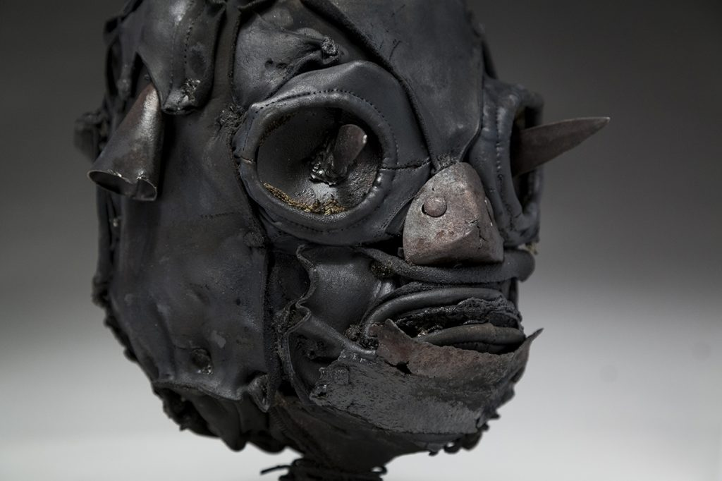 Ronald Gonzalez -  <strong>Daggers (detail)</strong> (2018<strong style = 'color:#635a27'></strong>)<bR /> black leather, found objects, wire, wax, carbon, screws and metal filings over welded steel armatures, 11 x 9 x 10 inches