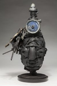 Ronald Gonzalez -  <strong>Dead Air</strong> (2018<strong style = 'color:#635a27'></strong>)<bR /> black leather, found objects, wire, wax, carbon, screws and metal filings over welded steel armatures, 18 x 10 x 8 inches
