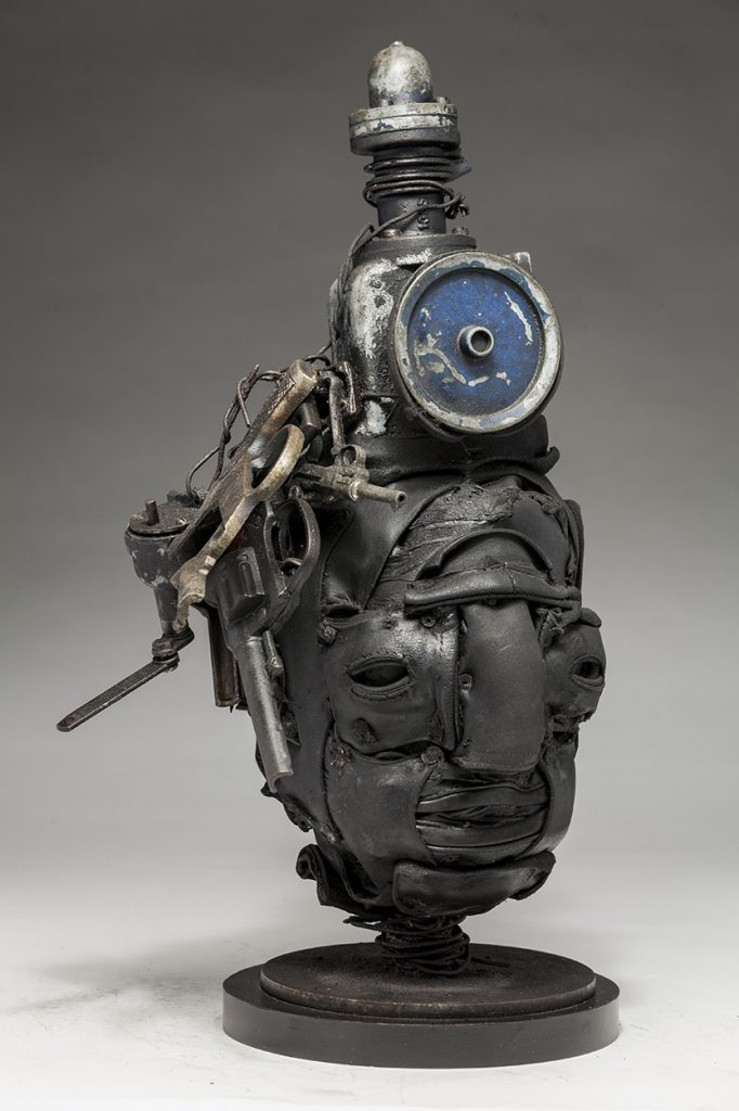 Ronald Gonzalez -  <strong>Dead Air (side)</strong> (2018<strong style = 'color:#635a27'></strong>)<bR /> black leather, found objects, wire, wax, carbon, screws and metal filings over welded steel armatures, 18 x 10 x 8 inches