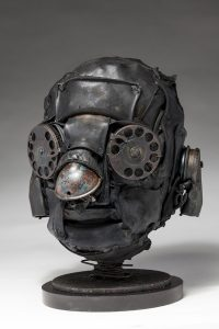 Ronald Gonzalez -  <strong>Distant Call (side)</strong> (2018<strong style = 'color:#635a27'></strong>)<bR /> black leather, found objects, wire, wax, carbon, screws and metal filings over welded steel armatures, 11 x 8 x 9 inches