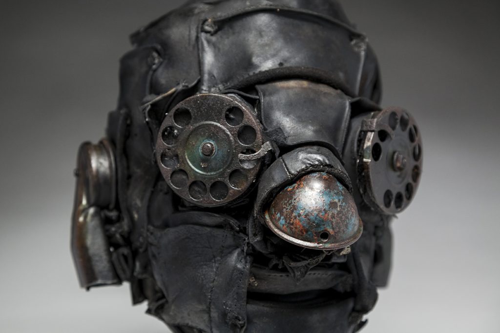 Ronald Gonzalez -  <strong>Distant Call (detail)</strong> (2018<strong style = 'color:#635a27'></strong>)<bR /> black leather, found objects, wire, wax, carbon, screws and metal filings over welded steel armatures, 11 x 8 x 9 inches