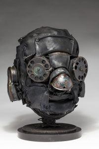 Ronald Gonzalez -  <strong>Distant Call</strong> (2018<strong style = 'color:#635a27'></strong>)<bR /> black leather, found objects, wire, wax, carbon, screws and metal filings over welded steel armatures, 11 x 8 x 9 inches
