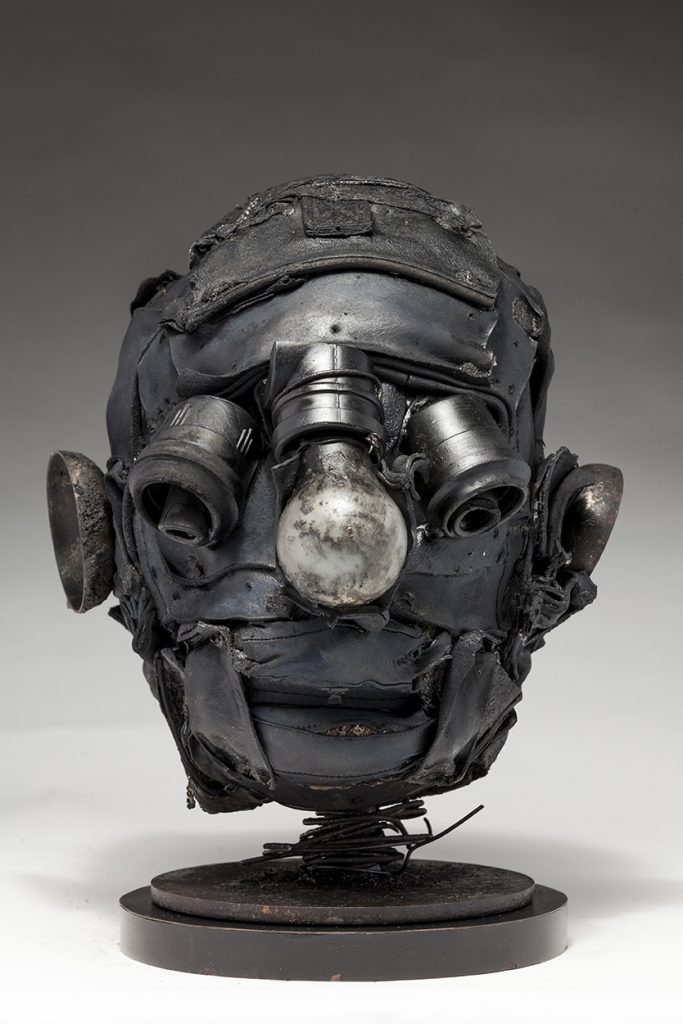 Ronald Gonzalez -  <strong>Empty Sockets</strong> (2018<strong style = 'color:#635a27'></strong>)<bR /> black leather, found objects, wire, wax, carbon, screws and metal filings over welded steel armatures, 11 x 9 x 10 inches