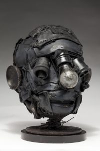 Ronald Gonzalez -  <strong>Empty Sockets (side)</strong> (2018<strong style = 'color:#635a27'></strong>)<bR /> black leather, found objects, wire, wax, carbon, screws and metal filings over welded steel armatures, 11 x 9 x 10 inches