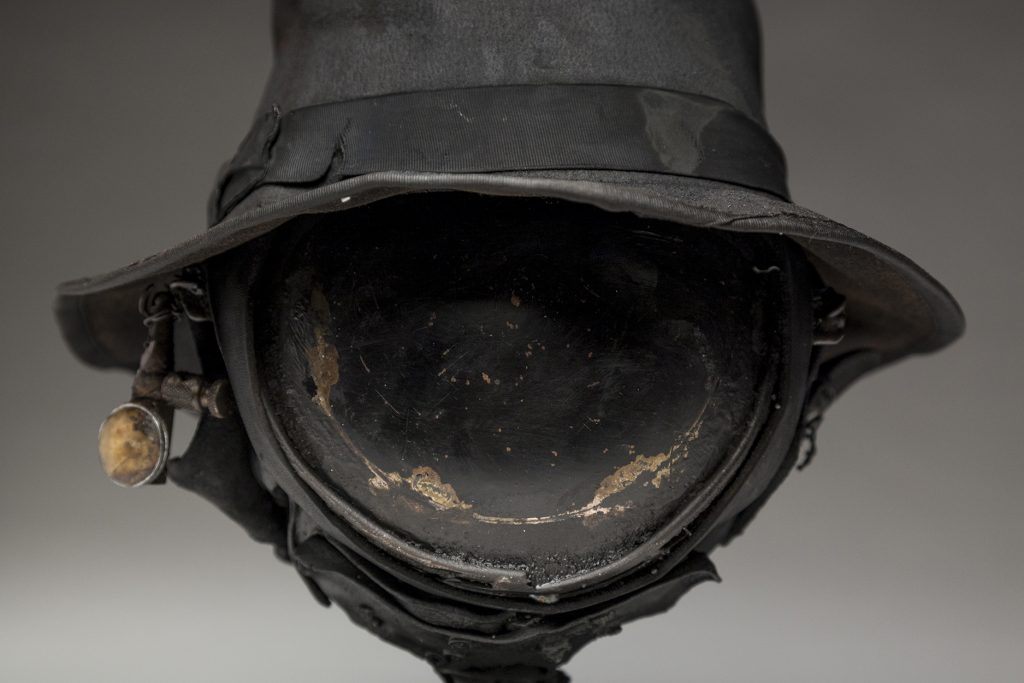 Ronald Gonzalez -  <strong>Eye (detail)</strong> (2018<strong style = 'color:#635a27'></strong>)<bR /> black leather, found objects, wire, wax, carbon, screws and metal filings over welded steel armatures, 12 x 11 x 11 inches