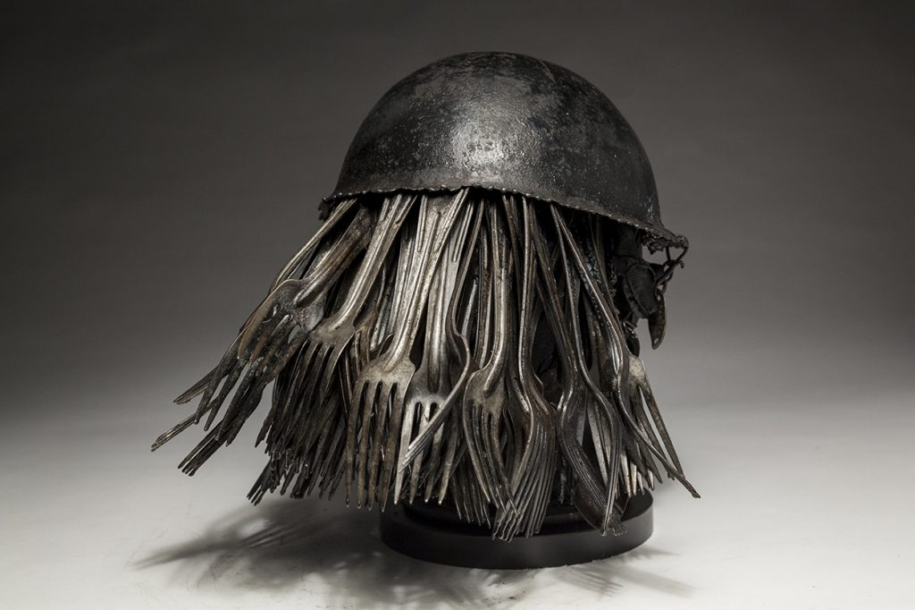 Ronald Gonzalez -  <strong>Feeding (side)</strong> (2018<strong style = 'color:#635a27'></strong>)<bR /> black leather, found objects, wire, wax, carbon, screws and metal filings over welded steel armatures.  	 12 x 11 x 11 inches