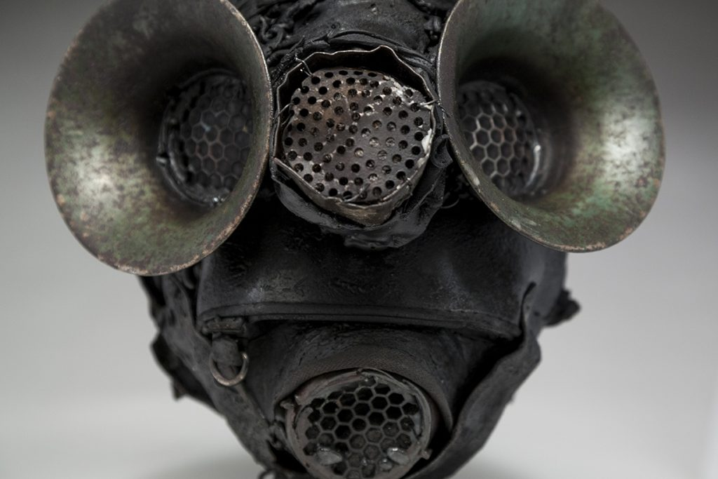Ronald Gonzalez -  <strong>Filters (detail)</strong> (2018<strong style = 'color:#635a27'></strong>)<bR /> black leather, found objects, wire, wax, carbon, screws and metal filings over welded steel armatures, 12 x 9 x 11 inches