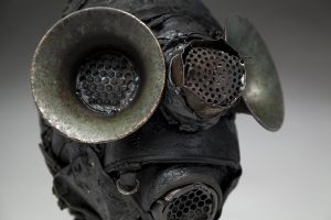 Ronald Gonzalez -  <strong>Filters (side)</strong> (2018<strong style = 'color:#635a27'></strong>)<bR /> black leather, found objects, wire, wax, carbon, screws and metal filings over welded steel armatures, 12 x 9 x 11 inches