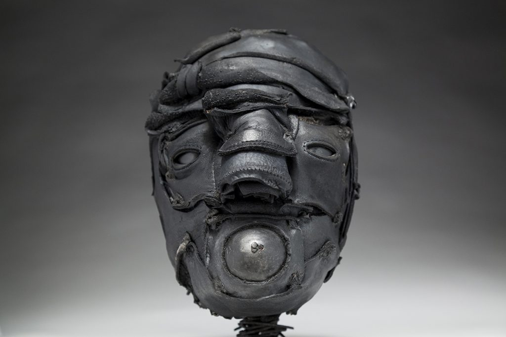 Ronald Gonzalez -  <strong>Gasp</strong> (2018<strong style = 'color:#635a27'></strong>)<bR /> black leather, found objects, wire, wax, carbon, screws and metal filings over welded steel armatures, 12 x 8 x 9 inches