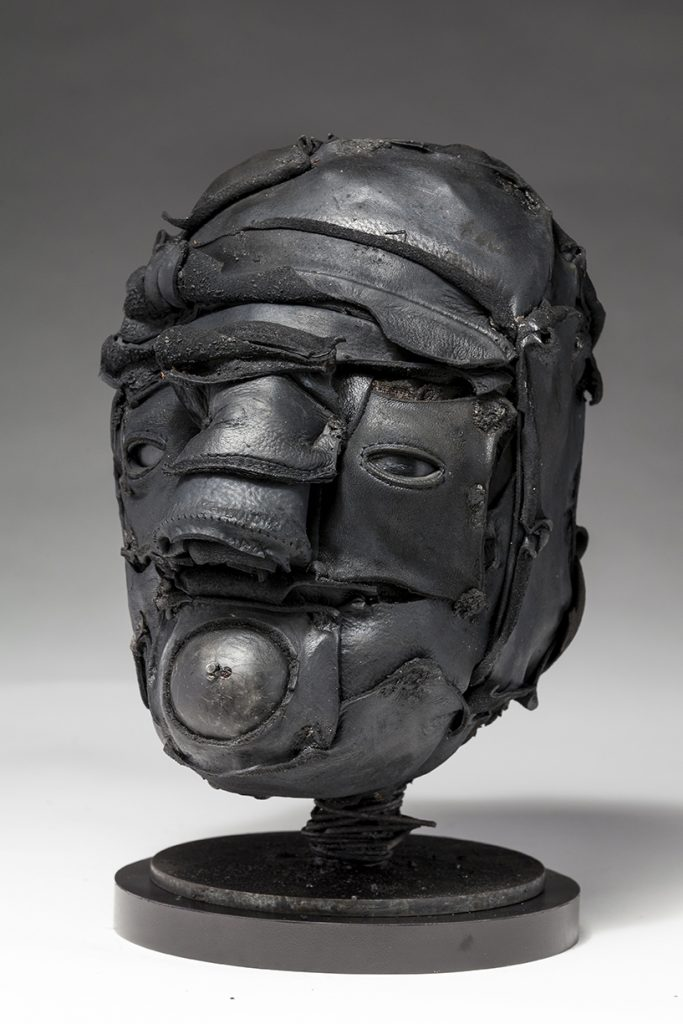 Ronald Gonzalez -  <strong>Gasp (side)</strong> (2018<strong style = 'color:#635a27'></strong>)<bR /> black leather, found objects, wire, wax, carbon, screws and metal filings over welded steel armatures, 12 x 8 x 9 inches