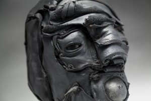 Ronald Gonzalez -  <strong>Gasp (detail)</strong> (2018<strong style = 'color:#635a27'></strong>)<bR /> black leather, found objects, wire, wax, carbon, screws and metal filings over welded steel armatures, 12 x 8 x 9 inches