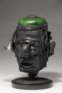 Ronald Gonzalez -  <strong>Green Cap (side)</strong> (2018<strong style = 'color:#635a27'></strong>)<bR /> black leather, found objects, wire, wax, carbon, screws and metal filings over welded steel armatures, 12 x 9 x 7 inches