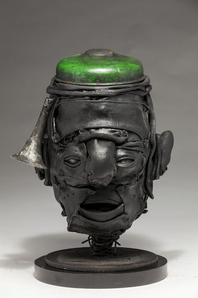 Ronald Gonzalez -  <strong>Green Cap</strong> (2018<strong style = 'color:#635a27'></strong>)<bR /> black leather, found objects, wire, wax, carbon, screws and metal filings over welded steel armatures, 12 x 9 x 7 inches