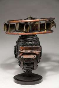 Ronald Gonzalez -  <strong>Halo</strong> (2018<strong style = 'color:#635a27'></strong>)<bR /> black leather, found objects, wire, wax, carbon, screws and metal filings over welded steel armatures, 14 x 12 x 12 inches