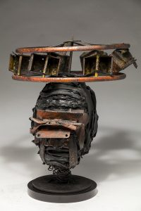 Ronald Gonzalez -  <strong>Halo (side)</strong> (2018<strong style = 'color:#635a27'></strong>)<bR /> black leather, found objects, wire, wax, carbon, screws and metal filings over welded steel armatures, 14 x 12 x 12 inches