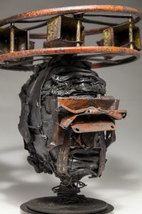 Ronald Gonzalez -  <strong>Halo (detail)</strong> (2018<strong style = 'color:#635a27'></strong>)<bR /> black leather, found objects, wire, wax, carbon, screws and metal filings over welded steel armatures, 14 x 12 x 12 inches